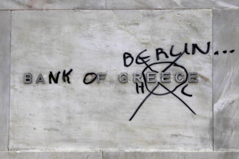 230054-a-bank-of-greece-sign-outside-the-institution-defiled-by-protesters-fr1